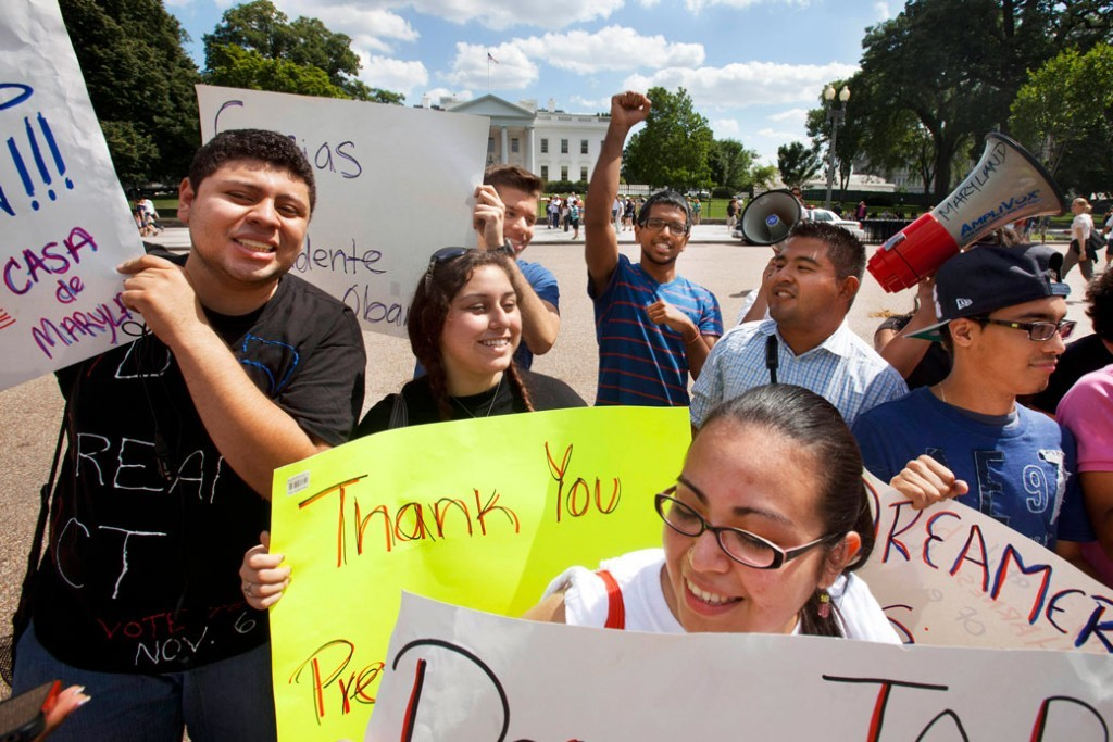 "In this June 15, 2012 photo, undocumented immigrants who live in Maryland, hold signs saying ""Thank You President Obama"" in Washington, D.C."