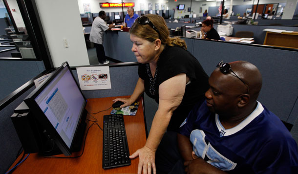 Linda Robinson and her husband Timothy use a computer to look for work at WorkForce One in Hollywood, Florida. Though the economy continued to make modest gains in August, policymakers must do more to ensure economic and job growth in the months to come.<br />