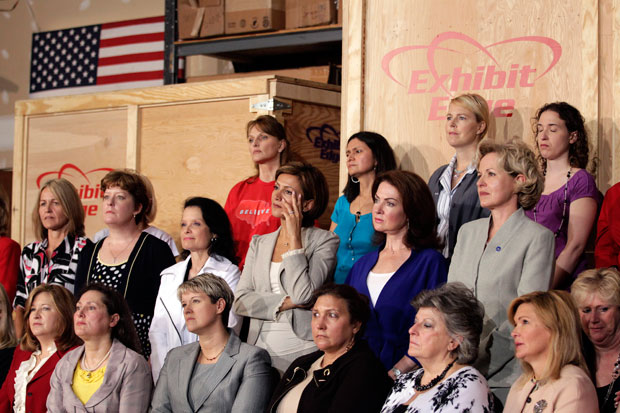 Women listen as Republican presidential candidate, former Massachusetts Gov. Mitt Romney speaks at a campaign stop in Chantilly, Virginiaa.