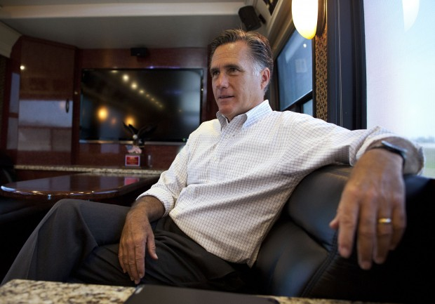 Republican presidential candidate and former Massachusetts Gov. Mitt Romney talks with his staff while riding on his bus after a campaign stop in Council Bluffs, Iowa.