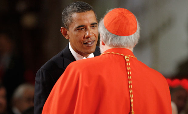President Barack Obama speaks with Cardinal Sean O'Malley, Archbishop of Boston, before the Roman Catholic Funeral Mass for Sen. Edward Kennedy (D-MA) in Boston in 2009. The Catholic voting bloc is being courted by both President Obama and his rival, Republican presidential nominee Mitt Romney.