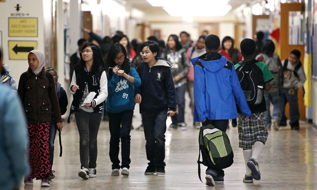 Students fill the halls between classes at Aki Kurose Middle School in Seattle.