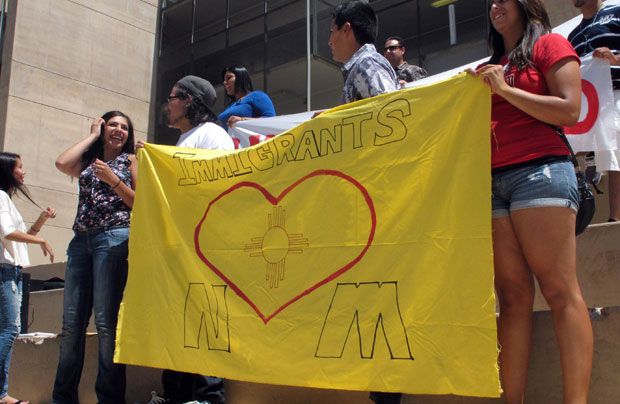 Students hold a rally to encourage young illegal immigrants to apply for new federal program aimed at allowing them to stay in the country, at the University of New Mexico in Albuquerque.