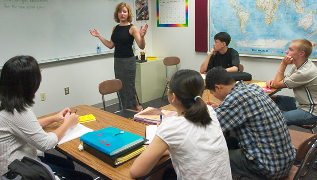 Westside High School English Language Learners teacher Susie Karnik, standing, interacts with her students. Waivers to No Child Left Behind requirements will vastly improve English language learners' education.