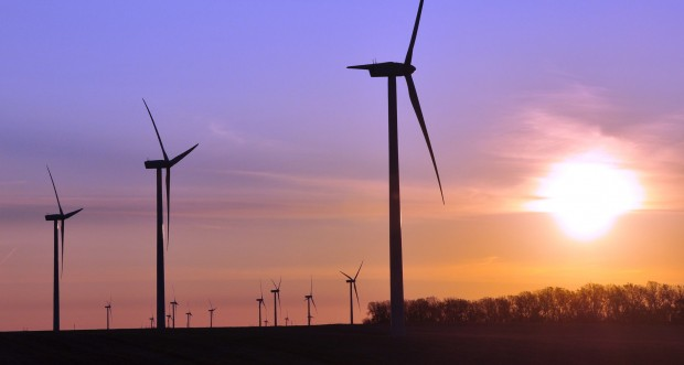 Turbines spin during sunrise at a wind farm