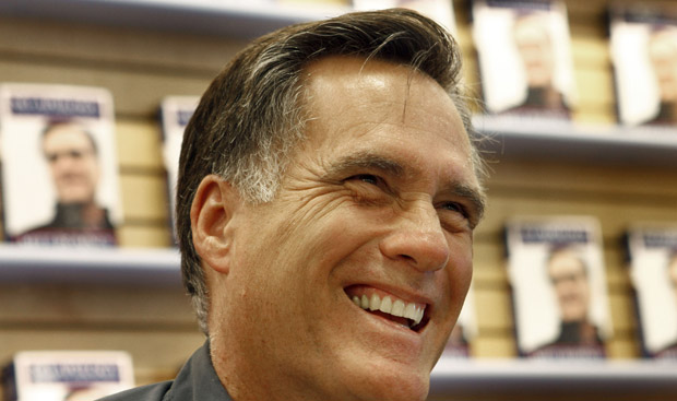 Gov. Romney at a book signing, smiling.