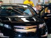 President Barack Obama gets behind the wheel of a new Chevy Volt during his tours of the General Motors Auto Plant in Hamtramck, Michigan.