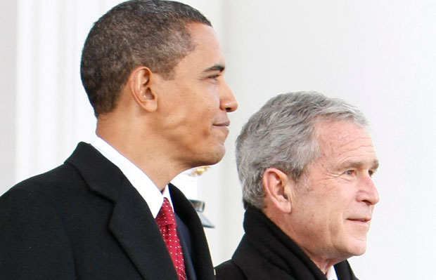 Former President George W. Bush, right, walks out with then-President-elect Barack Obama, left, on the North Portico of the White House before sharing the presidential limousine en route to Capitol Hill for the presidential inauguration in Washington, Tuesday, January 20, 2009.