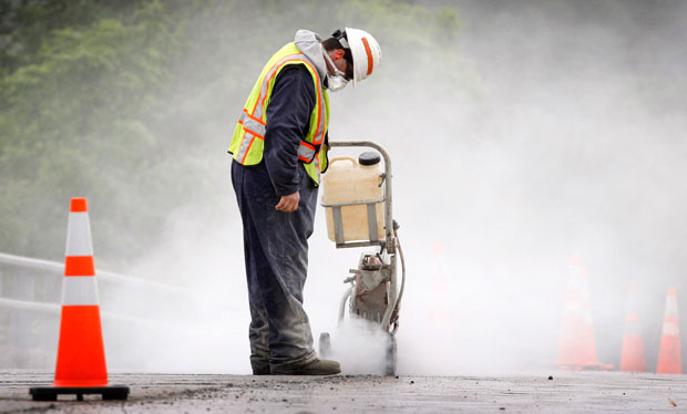 Maine Department of Transportation worker Alan Ladd creates a dust cloud while cutting concrete in Richmond, Maine. An infrastructure bank would organize spending on infrastructure and promote investment in infrastructure projects.