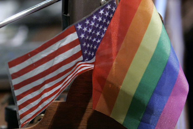 A rainbow flag, identified with the gay and transgender community, decorates the desk of Assemblyman Tom Ammiano (D-San Francisco) at the Capitol in Sacramento, California.