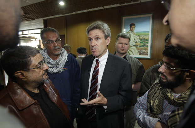 In this photo taken Monday, April 11, 2011, then-U.S. envoy Chris Stevens speaks to local media before attending meetings at the Tibesty Hotel where an African Union delegation was meeting with opposition leaders in Benghazi, Libya.