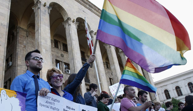 Gay rights activists stage a protest at the parliament building in Tbilisi, Georgia, Friday, May 18, 2012.