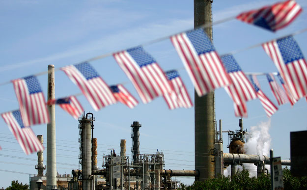 American flags hang near the Shell refinery, in Martinez, California. Gov. Romney and Rep. Ryan's economic plan would be bad news for Americans' public health and would largely benefit oil and gas companies.