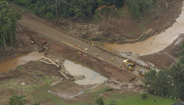A highway wiped out after the Kaloko Reservoir Dam burst near Kilauea, Hawaii, is shown Tuesday, March 14, 2006.