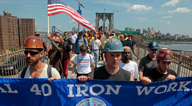 "A coalition of New York City unions rally for a ""March for the Middle Class"" across the Brooklyn Bridge to City Hall in 2011. Union membership provides an income boost to middle-class families and is good for economic growth."