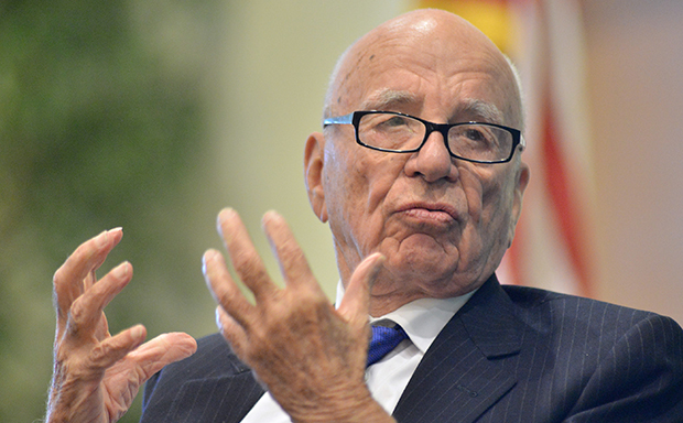 News Corp. CEO Rupert Murdoch speaks during a forum in Boston, Tuesday, August 14, 2012. Fox News and The Wall Street Journal, both owned by News Corp., have deliberately distorted the work of climate scientists for reasons of ideological obsession and financial gain.
