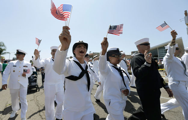 Sailors march in uniform during the gay pride parade in San Diego. Now that Don't Ask, Don't Tell has been repealed, we must do more to ensure nondiscriminatory policies are in place for our gay and transgender veterans.