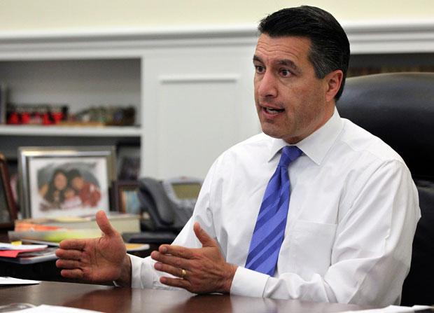 Nevada Gov. Brian Sandoval speaks in his office in Carson City, Nev.