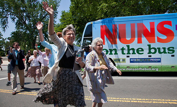 "Sister Simone Campbell, left, and Sister Diane Donoghue, right, lead the way as the the ""Nuns on the Bus"" arrive on Capitol Hill in Washington, Monday, July 2, 2012, after a nine-state tour to bring stories of hardship to Congress."