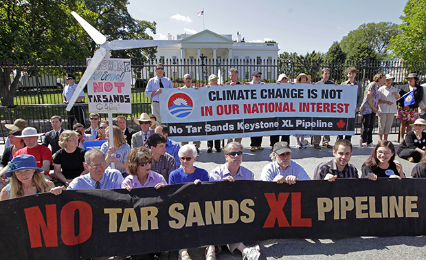 Environmental activists gather outside the White House in Washington, Monday, August 22, 2011, as they continue a civil disobedience campaign against the proposed Keystone XL oil pipeline from Canada to the U.S. Gulf Coast.