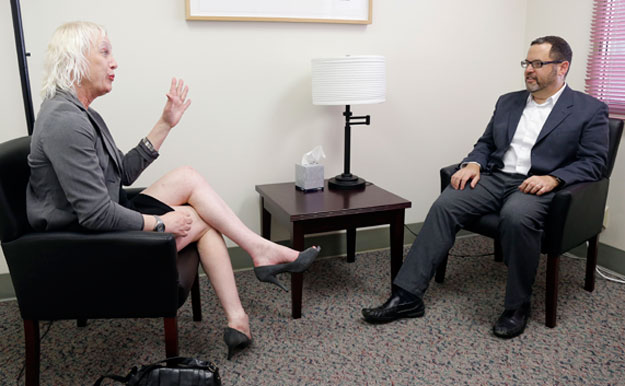 Rachel Sorrow, at left, a transgender woman, attends a therapy session with Dr. Dan Karasic, a psychiatrist with the Center of Excellence for Transgender Health. Lacking insurance coverage for transition-related care is one of the obstacles that many transgender Americans face.