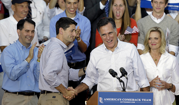 Republican presidential candidate Mitt Romney, right, is introduced by vice-presidential running mate Rep. Paul Ryan (R-WI) during a rally in Waukesha, Wisconsin, Sunday, August 12, 2012.
