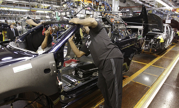An assemblyman works on the line building Chrysler 200 vehicles at the Sterling Heights Assembly Plant in Sterling Heights, Michigan.