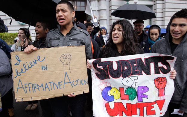 Sid Jacobo, left, and Jazel Flores, right, protest outside of the U.S. 9th Circuit Court of Appeals after a panel heard arguments in San Francisco earlier this year. The Supreme Court this week will hear arguments in an affirmative action case.