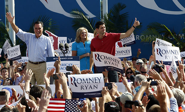 Republican presidential candidate Mitt Romney, left, and his vice-presidential running mate Rep. Paul Ryan (R-WI) greet supporters as they arrive at a campaign event, Saturday, September 1, 2012, in Jacksonville, Florida. Romney's wife Ann is at center.