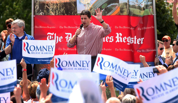 Republican vice presidential candidate Rep. Paul Ryan (R-WI), accompanied by Iowa Gov. Terry Branstad, left, speaks at the Iowa State Fair in Des Moines. The real cost of a Romney-Ryan presidency for Iowans would be steep, especially for seniors, students, and the middle class, among others.