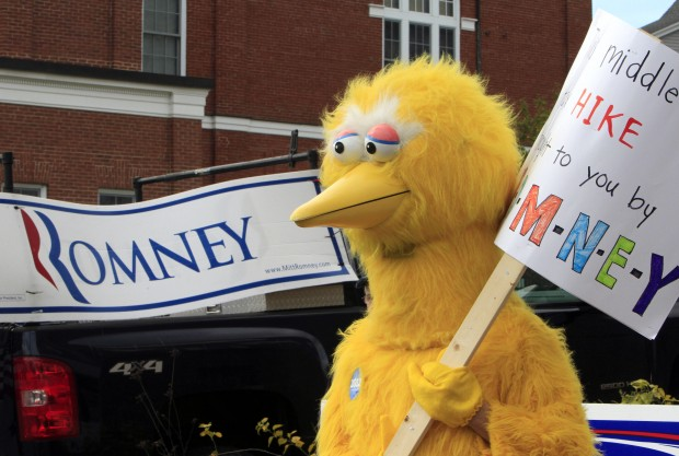 A person dressed as Big Bird holds a sign outside Republican presidential candidate, former Massachusetts Gov. Mitt Romney's headquarters in Derry, New Hampshire