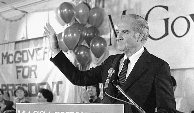 In this March 13, 1984, file photo, former Sen. George S. McGovern waves to supporters as he appears at his campaign headquarters in Boston, as results of the Massachusetts presidential preference primary were tallied.