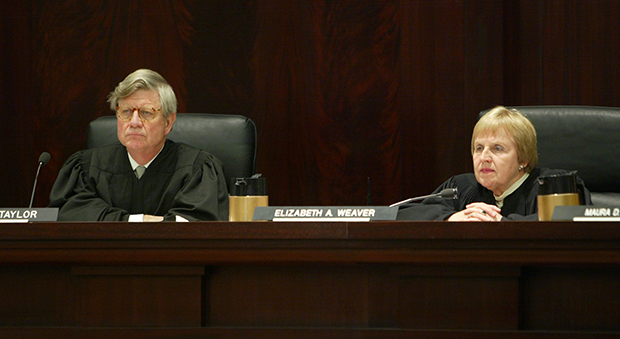Michigan Supreme Court Justice Elizabeth Weaver, right, and Chief Justice Clifford Taylor listen to oral arguments Thursday, January 11, 2007, in Lansing, Michigan. Data from recent Michigan Supreme Court elections clearly suggests that a partisan nominating process results in more campaign cash and a court where the justices' votes break along party lines.