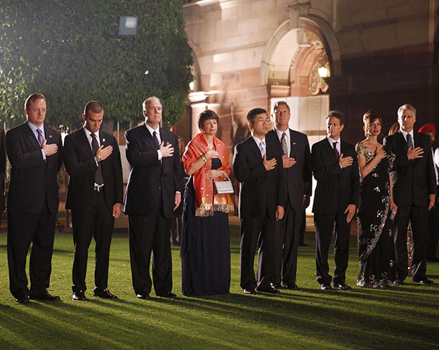 Members of the U.S. delegation stand during the playing of the U.S. national anthem during the state dinner for President Barack Obama and first lady Michelle Obama hosted by India's President Prathiba Patil and her husband Devisingh Ramsingh Shekhawat at Rashtrapati Bhavan in New Delhi, India, Monday, Nov. 8, 2010. From left are: Press Secretary Robert Gibbs, speech writer Jon Favreau, National Security Adviser Tom Donilon, senior adviser Valerie Jarrett, Commerce Secretary Gary Locke, Agriculture Secretary Tom Vilsack, Treasury Secretary Timothy Geithner, U.S. Ambassador to India Tim Roemer and wife Sally.