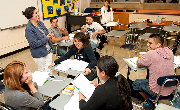 Pilar Quinn, a volunteer, teaches a GED preparation class at Marist School, in Atlanta, Georgia, Thursday, October 11, 2012. The class is for immigrants who are applying for the Deferred Action for Childhood Arrivals.