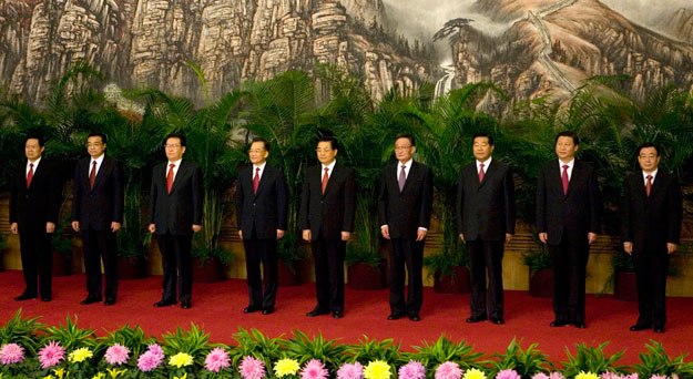 Communist Party General Secretary and Chinese President Hu Jintao, center, stands with the current members of the Politburo Standing Committee in Beijing's Great Hall of the People in 2007. The 18th Communist Party Congress meeting next week will usher in a new cadre of leaders of the Standing Committee who will be in office until 2017.
