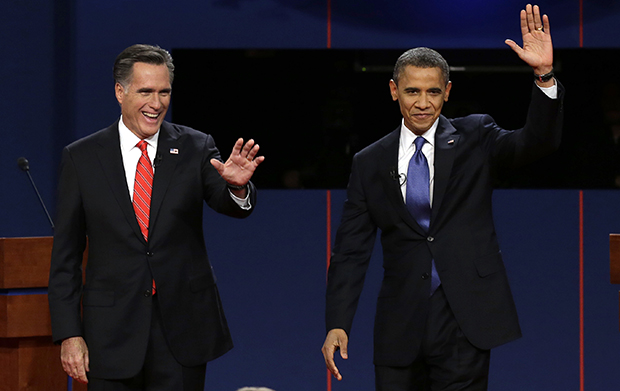 Republican presidential candidate Mitt Romney and President Barack Obama wave to the audience during the first presidential debate at the University of Denver in Denver, Wednesday, October 3, 2012.