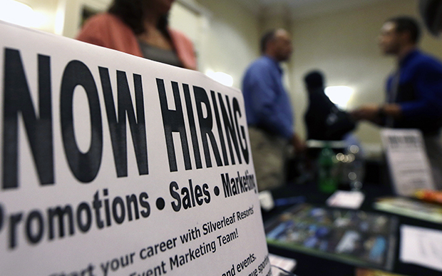 A sign attracts job seekers during a job fair at the Marriott Hotel in Colonie, New York, Thursday, October 25, 2012.