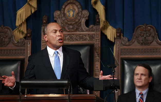 Massachusetts Gov. Deval Patrick, left, delivers his State of the State address in the House Chamber at Statehouse in Boston, January 23, 2012, as Lt. Gov. Timothy Murray, right, looks on. Massachusetts is a leader in the use of social impact bonds.