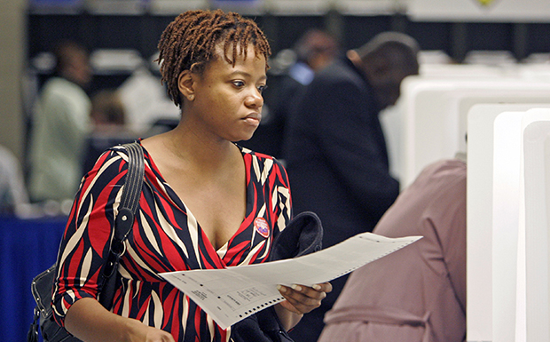 A woman prepares to vote after registering at the Cuyahoga County Board of Elections in Cleveland.