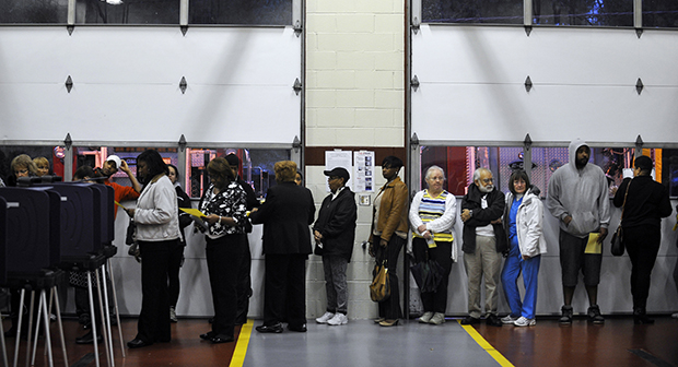 Voters wait in line to cast their ballots at the Mauldin Fire Station on Election Day, Tuesday, November 6, 2012, in Mauldin, South Carolina.