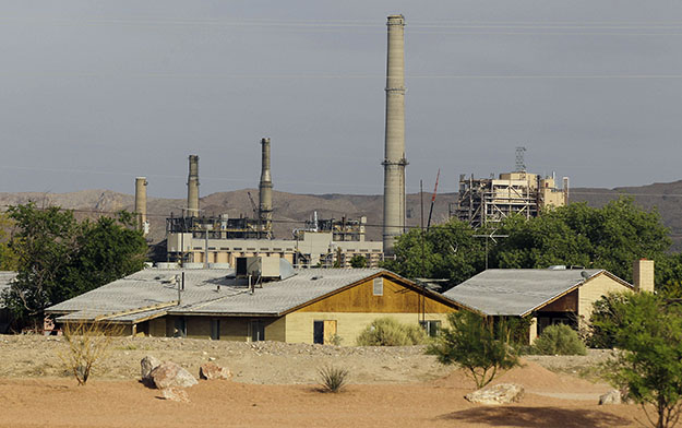 The Reid-Gardner power station is seen just beyond homes on the Moapa Indian Reservation, in Moapa, Nevada.