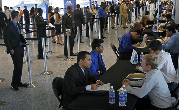 Job applicants are interviewed by Florida Marlins staff at Marlins Park in Miami, Wednesday, October 24, 2012.