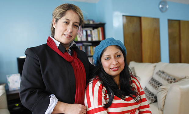 "Gabriella Trujillo, left, and Cristina Garcia pose for a photo in Garcia's home in the Queens borough of New York, Thursday, November 1, 2012. Trujillo and Garcia are undocumented immigrants who have participated in ""get out the vote"" campaigns although they can't vote themselves."
