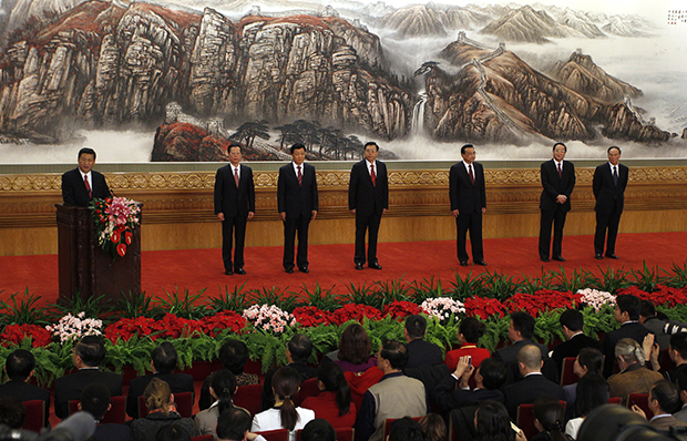 Chinese Communist Party General Secretary Xi Jinping, left, speaks as other new members of the Politburo Standing Committee, from second left, Zhang Gaoli, Liu Yunshan, Zhang Dejiang, Li Keqiang, Yu Zhengsheng, and Wang Qishan, stand in Beijing's Great Hall of the People, Thursday, November 15, 2012.