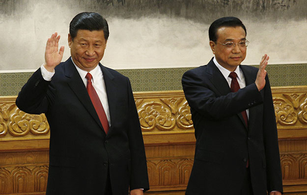 From left, members of the new Politburo Standing Committee Xi Jinping and Li Keqiang wave as they meet journalists in Beijing's Great Hall of the People on Thursday, November 15, 2012. The seven-member Standing Committee, the inner circle of Chinese political power, was paraded in front of assembled media on the first day following the end of the 18th Communist Party Congress.