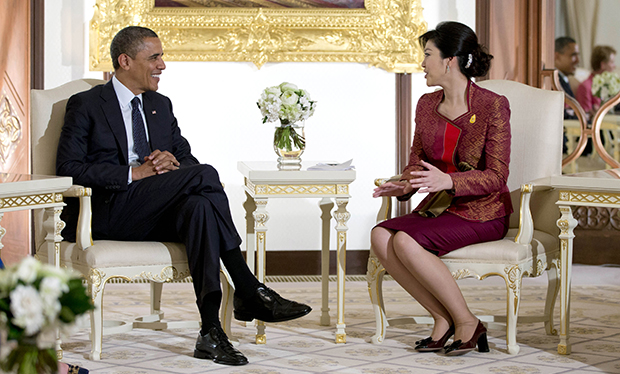 U.S. President Barack Obama, left, and Thai Prime Minister Yingluck Shinawatra talk before a meeting at Government House in Bangkok, Thailand, Sunday, November 18, 2012.