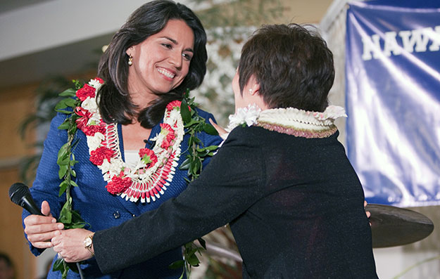 Democrat Colleen Hanabusa, right, congratulates candidate Tulsi Gabbard after both women won their Hawaii Congressional district seats at the Japanese Cultural Center in Honolulu, Tuesday, November 6, 2012. Gabbard, 31, is the first Hindu to win an election for Congress, where she will also be the first member born in the U.S. territory of American Samoa.