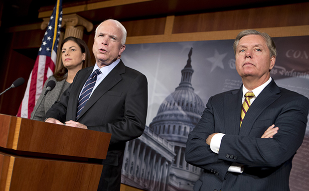 Sen. John McCain (R-AZ), center, accompanied by Sen. Kelly Ayotte (R-NH), left, and Sen. Lindsey Graham (R-SC), speaks during a news conference on Capitol Hill, Wednesday, November 14, 2012. Sens. McCain and Graham's criticism of U.N. Ambassador Susan Rice has harmed the reputation of the Republican Party with black voters.