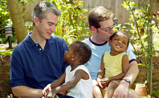 Olivier du Wulf, left, holds his son Laurent, 3, and Steven Boulliane, right, holds his son Patrice, 2, at their home in San Francisco. The Supreme Court must repeal the Defense of Marriage Act in order to ensure that families headed by gay couples have access to the same rights and benefits that opposite-sex spouses and their families do.